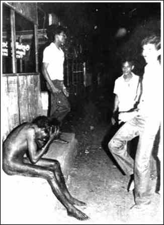1983 pic by Chandraguptha Amarasingha - A Tamil boy stripped naked and later beaten to death by Sinhala youth in Boralla bustation