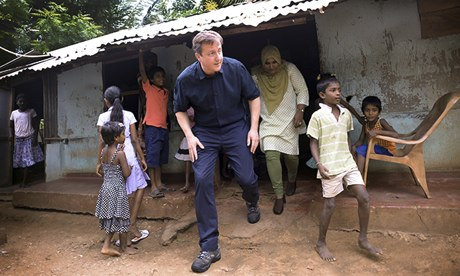 David Cameron meets Tamil refugees in the Sabapathy Pillai refugee camp in Jaffna, northern Sri Lanka. Photograph: Stefan Rousseau/PA / Guardian