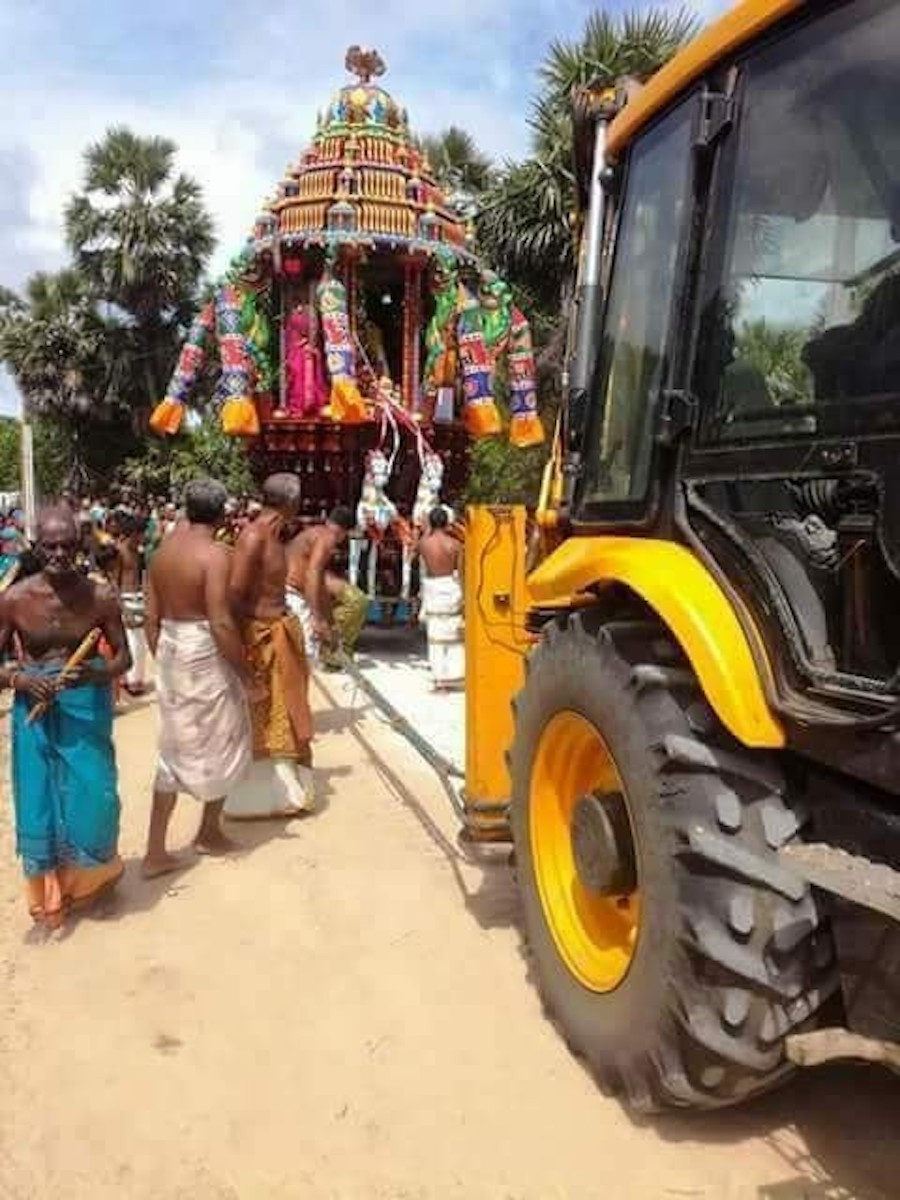 [ God being taken for a ride: photograph via newjaffna.com ]